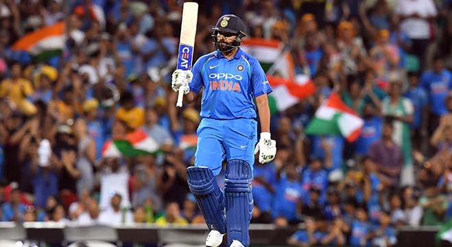 India's batsman Rohit Sharma celebrates scoring 100 runs to reach a century during the first one-day international (ODI) match between Australia and India at the Sydney Cricket Ground in Sydney on January 12, 2019. (Photo by Saeed Khan / AFP) / -- IMAGE RESTRICTED TO EDITORIAL USE - STRICTLY NO COMMERCIAL USE --