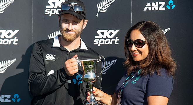 New Zealand's captain Kane Williamson is presented with a trophy by NZ Cricket director Diane Puketapu after the team won the ODI series against Sri Lanka following their third ODI cricket match at Saxton Field in Nelson on January 8, 2019. (Photo by Marty MELVILLE / AFP)