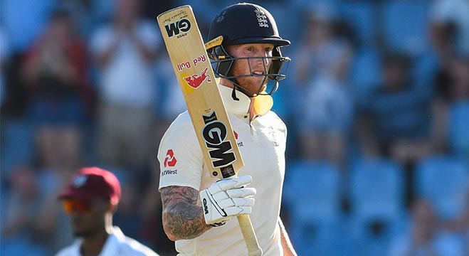 Ben Stokes of England celebrates his half century during day 1 of the 3rd and final Test between West Indies and England at Darren Sammy Cricket Ground, Gros Islet, Saint Lucia, on February 09, 2019. (Photo by Randy Brooks / AFP)