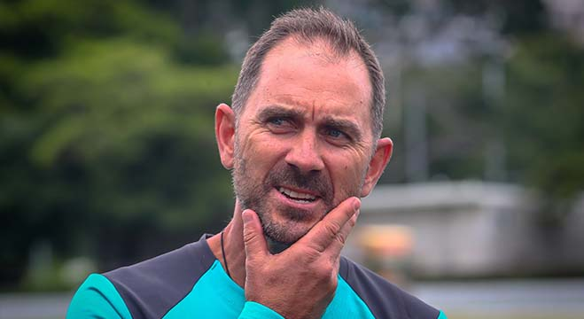 Australia's cricket coach Justin Langer takes part in a press briefing on the sidelines of a team cricket training session in the Albion suburb of Brisbane on May 3, 2019. (Photo by Patrick HAMILTON / AFP) / --IMAGE RESTRICTED TO EDITORIAL USE - STRICTLY NO COMMERCIAL USE--
