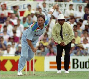 Ian Botham of England follows through during the World Cup cricket match against Australia in Sydney 05 March 1992, in which he took 4 wickets and scored 53 runs and was declared Man of the Match. England won with eight wickets in hand.