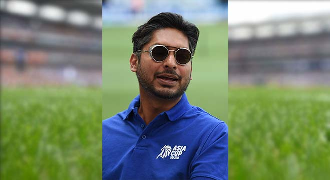 Former Sri Lankan cricket captain Kumar Sangakkara looks on as he gives some TV commentary during the one day international (ODI) Asia Cup cricket match between Bangladesh and Sri Lanka at the Dubai International Cricket Stadium in Dubai on September 15, 2018. (Photo by Ishara S. KODIKARA / AFP)