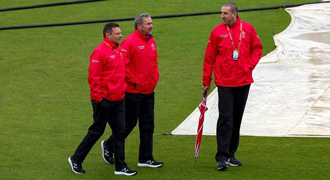 Umpires Richard Kettleborough, Richard Illingworth and Michael Gough inspect the pitch after rain delayed the start of the 2019 Cricket World Cup group stage match between Bangladesh and Sri Lanka at Bristol County Ground in Bristol, southwest England, on June 11, 2019. (Photo by GEOFF CADDICK / AFP) / RESTRICTED TO EDITORIAL USE