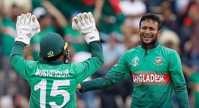 Bangladesh's Shakib Al Hasan (R) celebrates with teammate Mushfiqur Rahim after the dismissal of Afghanistan's Najibullah Zadran during the 2019 Cricket World Cup group stage match between Bangladesh and Afghanistan at the Rose Bowl in Southampton, southern England, on June 24, 2019. (Photo by Adrian DENNIS / AFP) / RESTRICTED TO EDITORIAL USE
